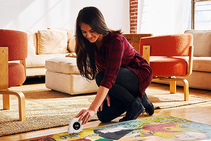 Woman measuring her carpet